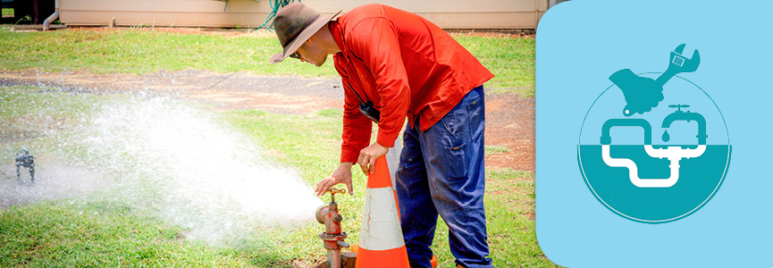 Isaac Regional Council staff member open tap of mains during air scouring process