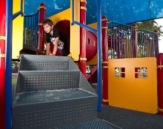 Boy climbing oin playground