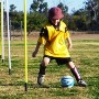 Girl doing soccer drills