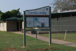 Carmila library sign post outdoors