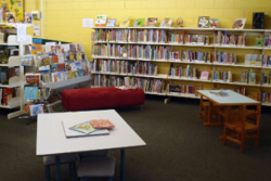 Middlemount library indoors, showing bookshelves and tables and chairs