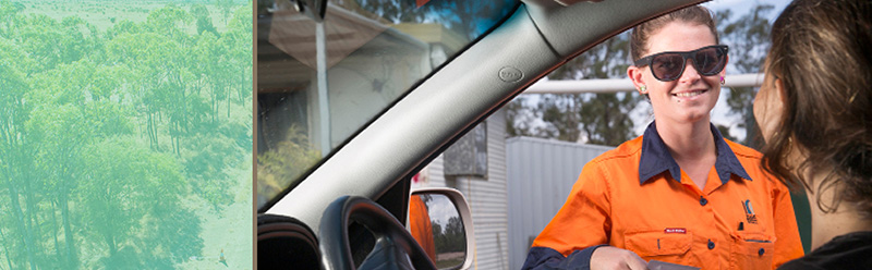 Council worker talking to driver through window of a car