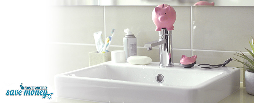 bathroom sink with toy pig on top of the tap